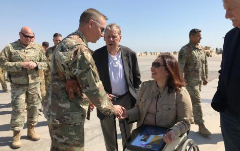 U.S. Sens. Tammy Duckworth (D-Ill.), Johnny Isakson (R-Ga.) and Angus King (I-Maine) meet with troops in Iraq. Duckworth led a bipartisan congressional delegation on a trip to the country last week.