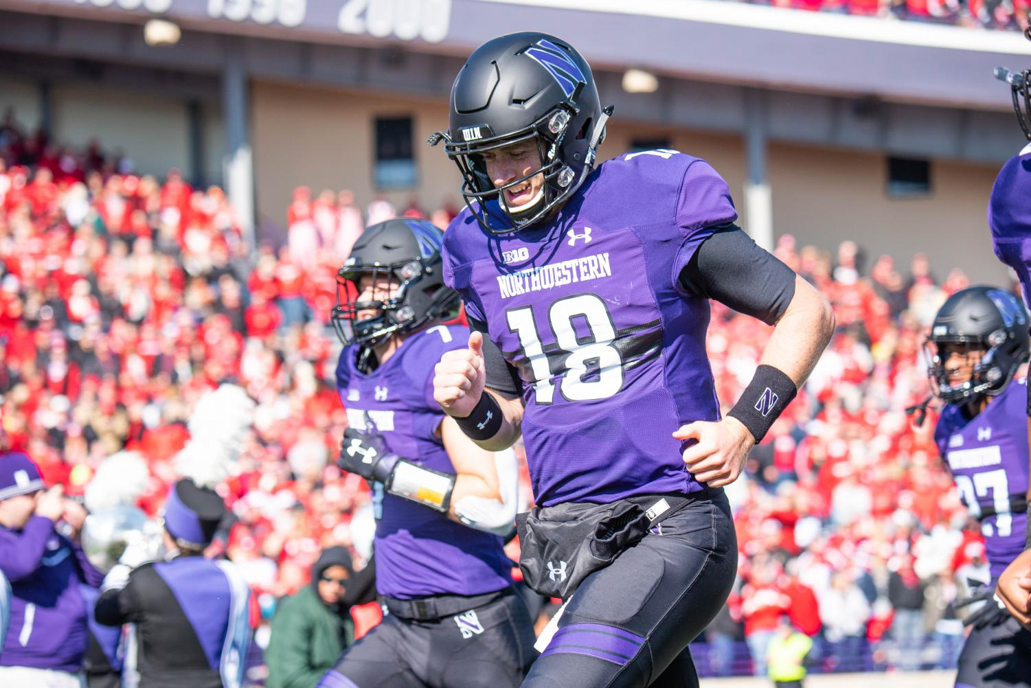 Clayton Thorson takes the field ahead of a 2018 game. The former NU quarterback was drafted by the Philadelphia Eagles on Saturday.