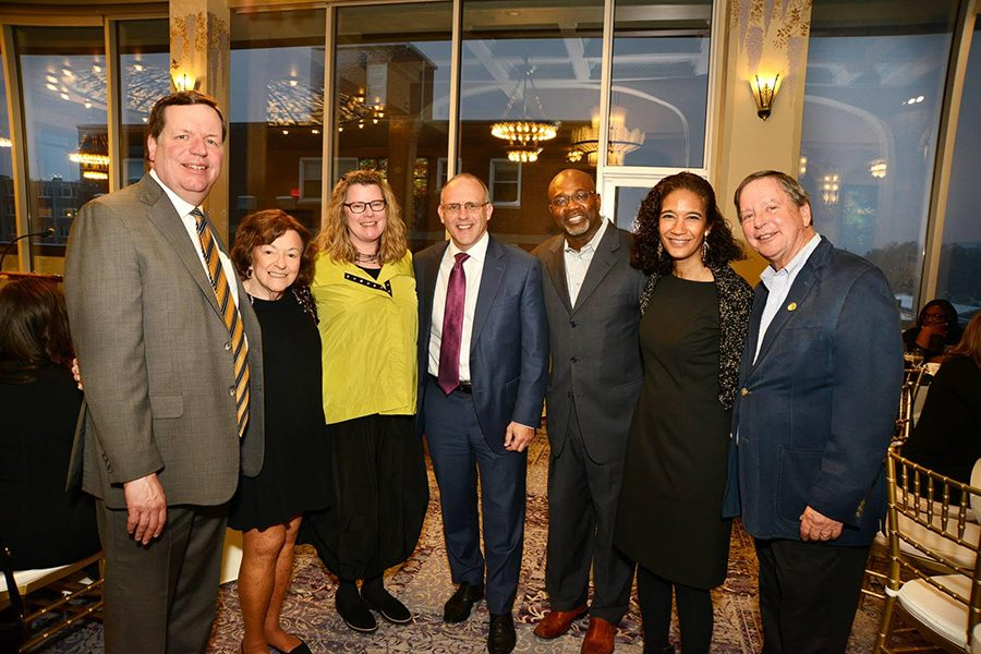 Joe Moore, Ald. Ann Rainey (8th), Britt Shawver, Mayor Steve Hagerty, Ald. Peter Braithwaite (2nd), Michelle Saddler and Denis Pierce (from left) at Welcome Home to Evanston. The event raised $150,000 for Housing Opportunities for Women.
