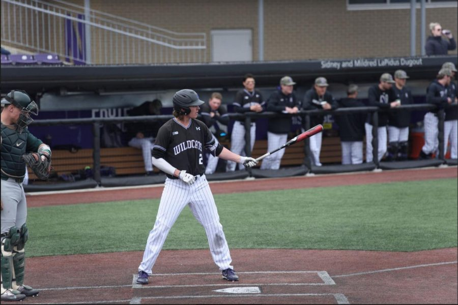 Jack Dunn stands at home plate. After collecting his 200th hit earlier this week, the senior went hitless in the Cats' loss to UIC on Wednesday.