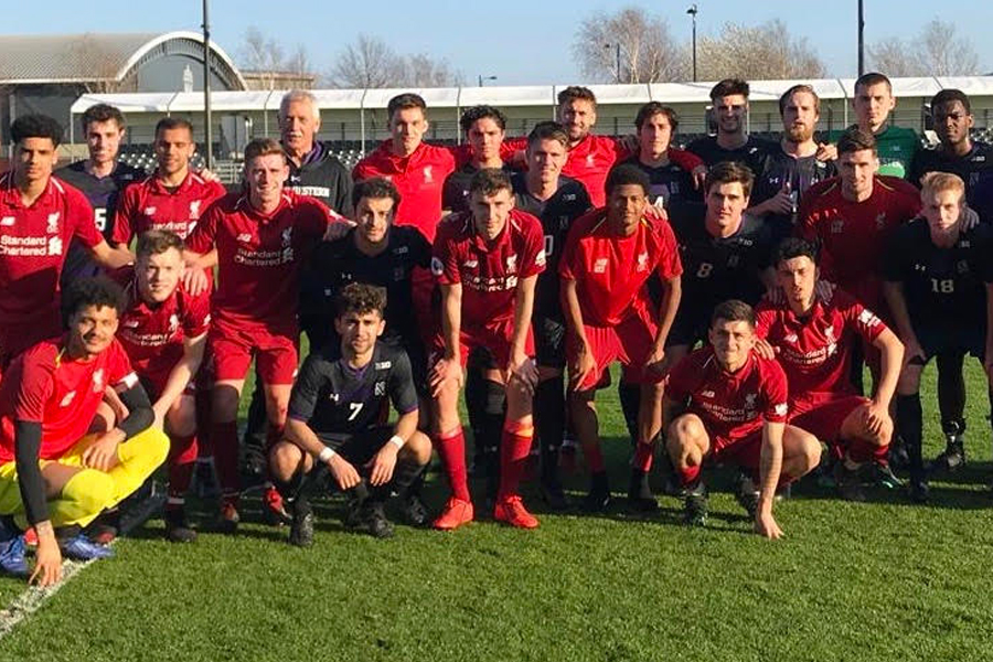 Northwestern poses with the Liverpool U-23 team. The Cats traveled to Spain and England over spring break, playing some of the top youth teams in Europe.