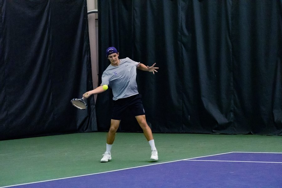 Chris+Ephron+hits+the+ball.+The+junior+won+both+of+his+singles+matches+against+Iowa+and+Nebraska.