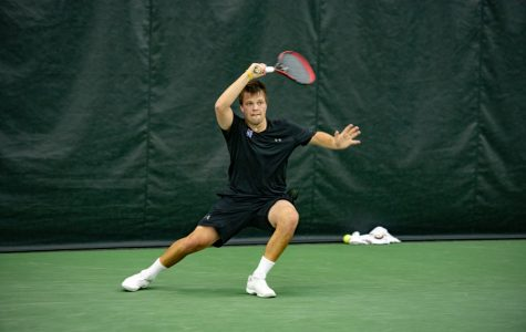 Dominik Stary prepares to hit the ball. The junior fell at No. 1 singles in NU's Big Ten Tournament match against Purdue this weekend.