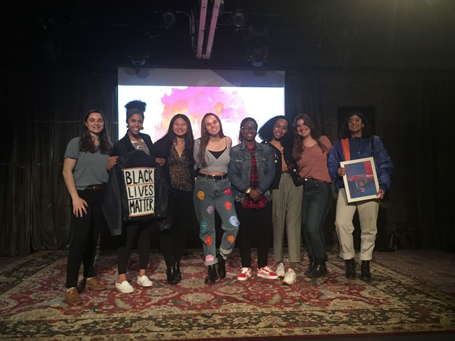The Northshore Association of Student Activists board members, artists and guests pose for a picture. NASA held an event showcasing student activist art Sunday.
