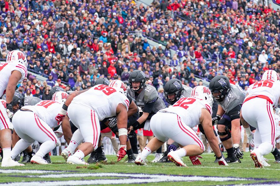 The+offensive+line+squares+up+against+Wisconsin.+Coach+Kurt+Anderson+was+pleased+with+the+group%E2%80%99s+progress+at+the+end+of+spring+practice.