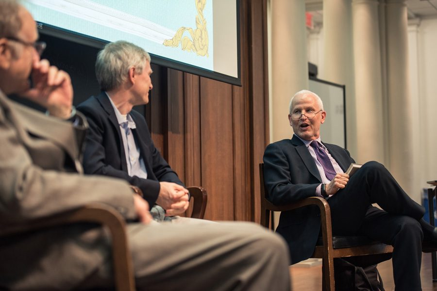 "Morton Schapiro, right, and Gary Morson, left, discuss their book ""Cents and Sensibility: What Economics Can Learn from the Humanities"" in 2017. Schapiro and Morson co-authored an op-ed in The Washington Post arguing that more people should think like economists."