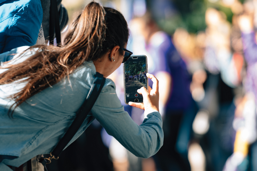 A parent takes a photo during Wildcat Welcome. Parents can connect to each other through various Facebook groups.