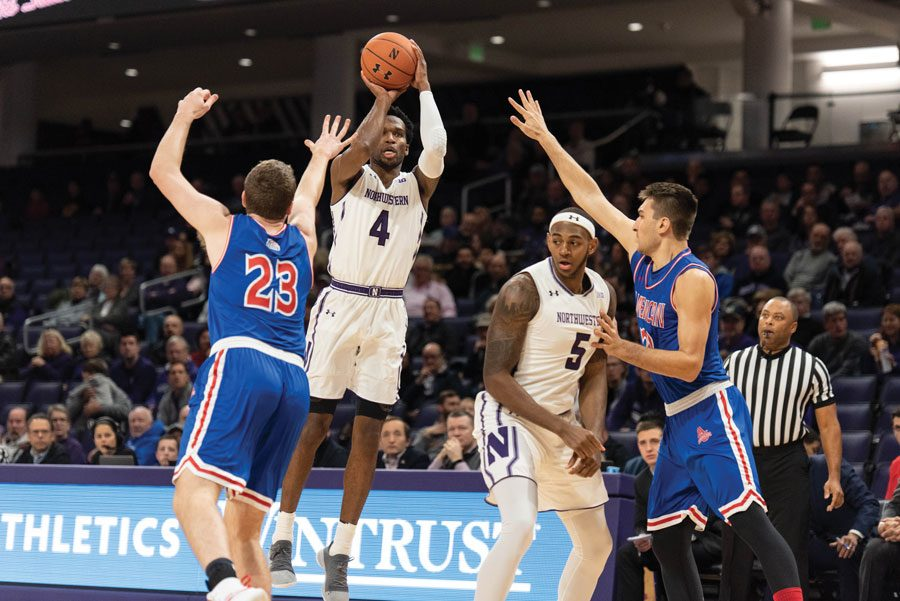Vic+Law+shoots+as+Dererk+Pardon+watches+in+a+2018+game.+The+two+were+invited+to+play+in+this+year%E2%80%99s+Portsmouth+Invitational+Tournament.