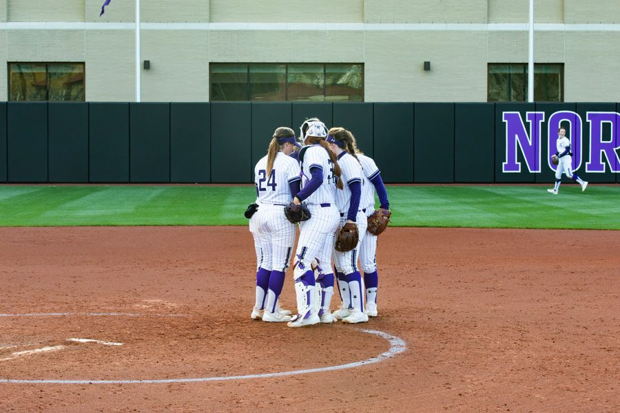 The+Wildcats+talk+at+the+mound.+NU+will+look+to+continue+its+11-game+win+streak+this+weekend+against+Purdue.