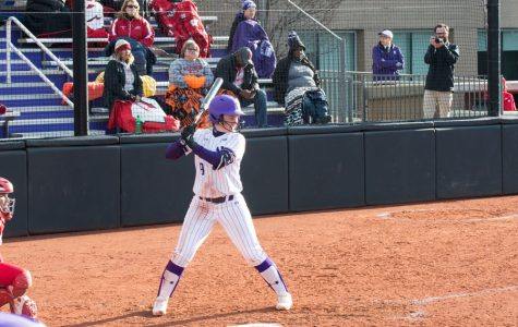 Lily Novak takes up her stance. The senior hit a walk-off home run to secure a sweep for the Wildcats against Wisconsin.