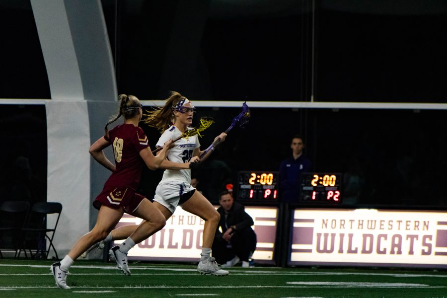 Claire+Quinn+brings+the+ball+down+the+field.+The+senior+scored+a+career-high+five+goals+in+NU%E2%80%99s+win+over+Johns+Hopkins.