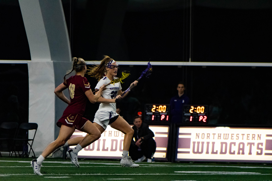 Claire Quinn brings the ball down the field. The senior scored a career-high five goals in NU's win over Johns Hopkins.