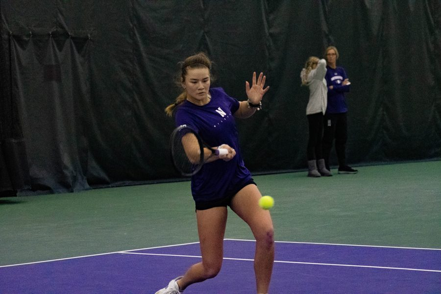 Clarissa+Hand+hits+the+ball.+The+freshman+helped+lead+the+Cats+to+five+straight+victories+in+March.+