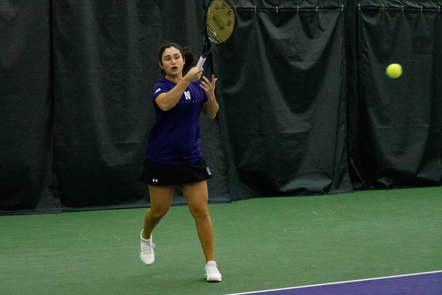 Inci Ogut hits the ball. The sophomore and the Wildcats open Big Ten Tournament play against Ohio State on Friday.