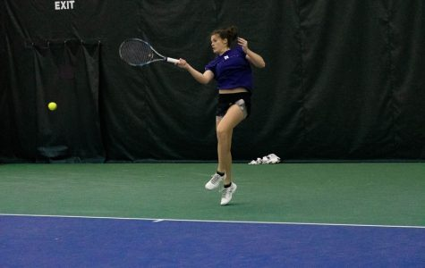 Julie Byrne hits the ball. The junior won both her singles matches in the Cats' Big Ten defeats this weekend.