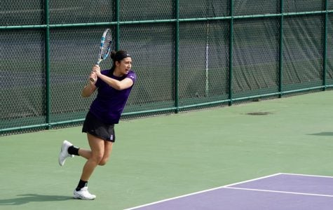 Lee Or hits the ball. The senior was the only player to win both of her singles matches last weekend for NU.