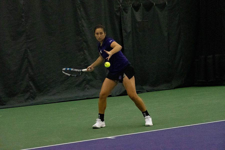 Lee Or hits the ball. The senior won all four matches she played in NU's final regular season weekend.