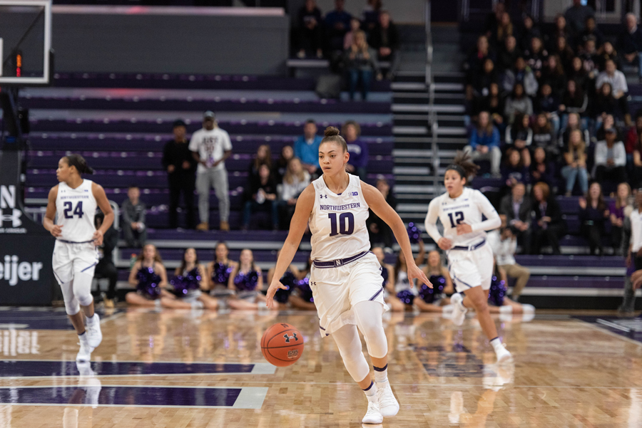 Lindsey Pulliam brings the ball up the court. The sophomore is playing some of the best basketball of her career this postseason.