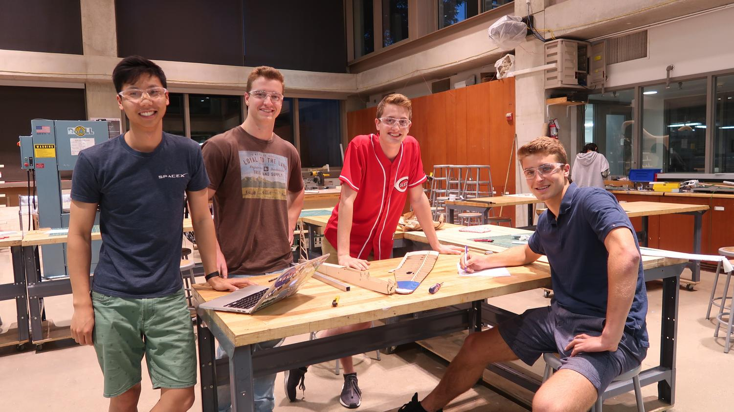 From left to right: Lawrence Luo, Griffin Williamson, Grant Bayer, and Cuyler Dull continuing their work on their plane.