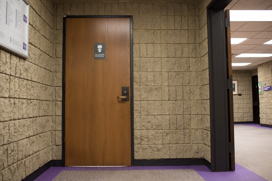 A gender-neutral sign on a single-occupancy bathroom. A bill passed through the Illinois legislatures that would require single-occupancy restrooms be labeled as gender-neutral in public spaces.