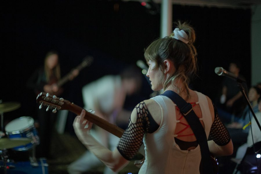 An artist plays the guitar on stage. Transference Fest took place on May 24 and May 25.