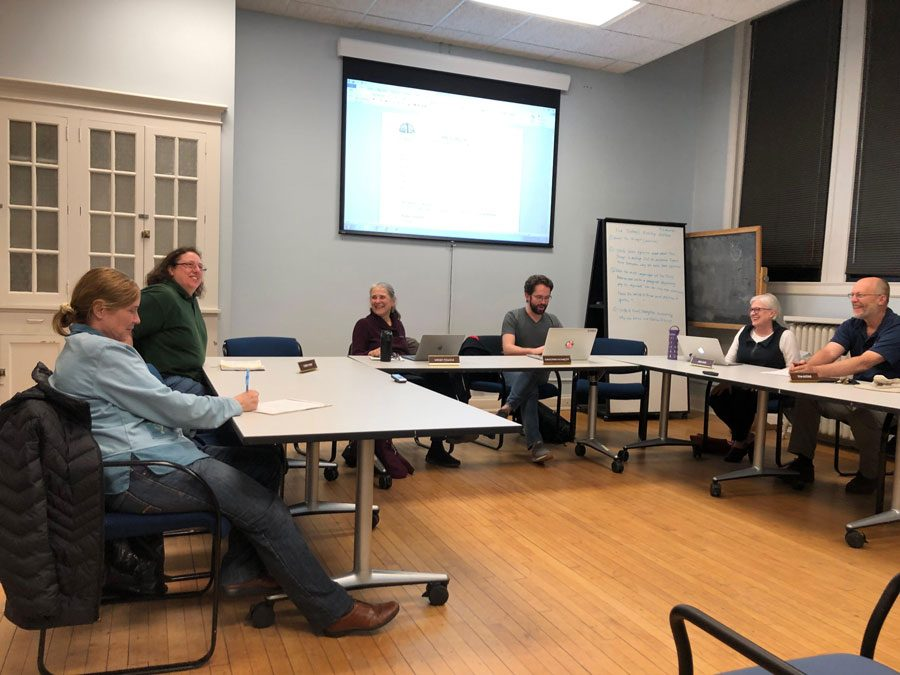 The City of Evanston's Environment Board. Board members discuss the implementation of a recently enacted climate action plan.