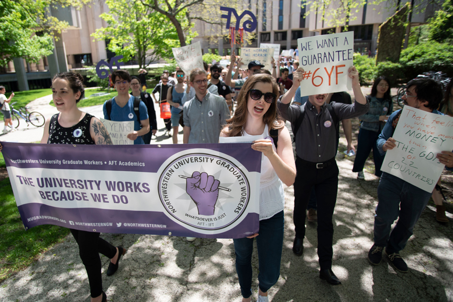 Graduate students march from Main Library to Rebecca Crown Center. Students, led by Northwestern Graduate Workers, rallied in support of guaranteed sixth-year funding on Thursday afternoon.