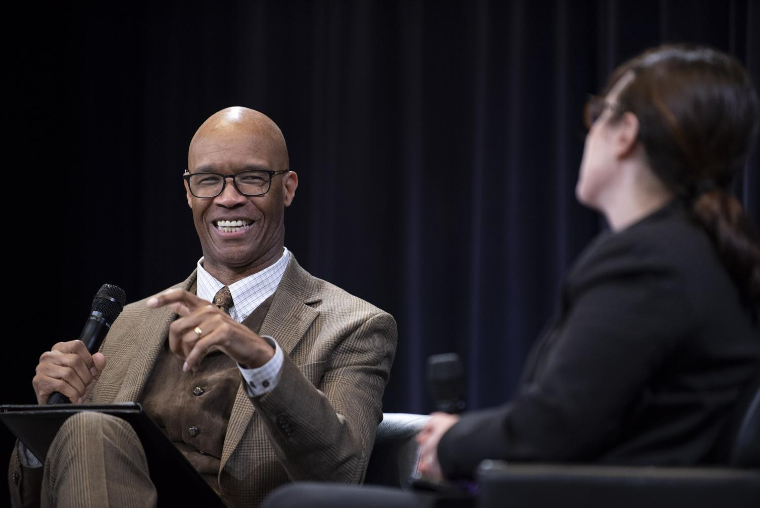 Charles Whitaker at an event last month speaking with New York Times reporter Maggie Haberman. Whitaker was named the dean of Medill Wednesday.