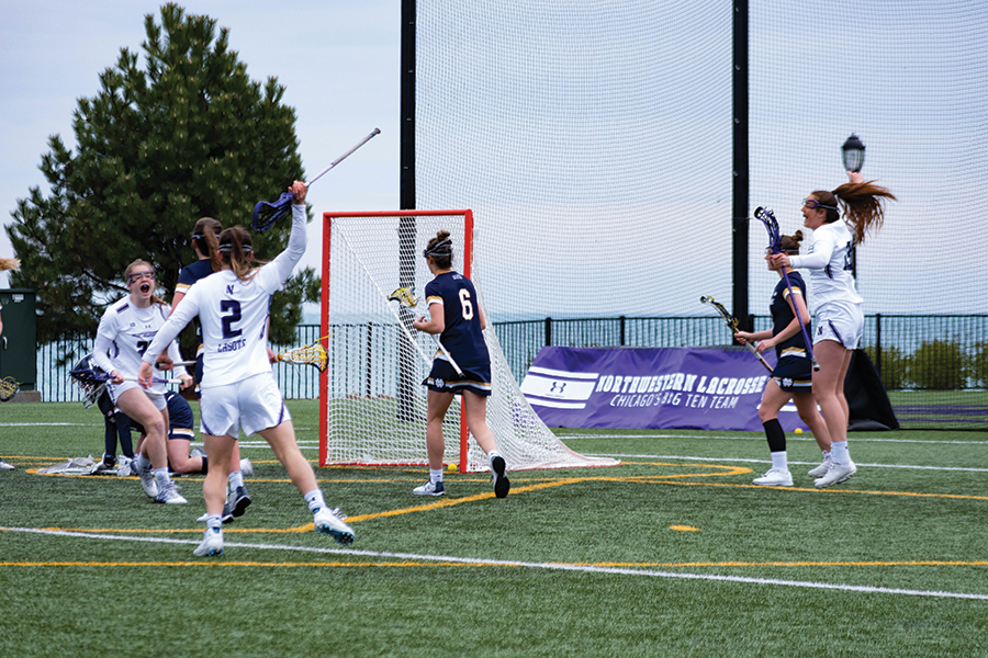 The Wildcats celebrate after a goal. NU beat Notre Dame in the second round of the NCAA Tournament at home Sunday.