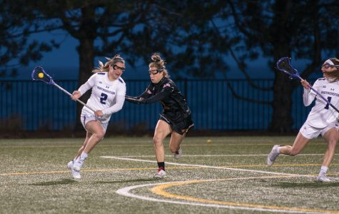 Selena Lasota maneuvers around a defender. The senior was named a finalist for lacrosse's most prestigious award last week.