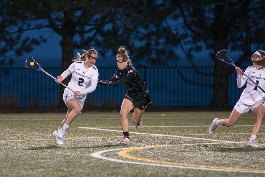 Selena Lasota maneuvers around a defender. The senior was named a finalist for lacrosse's most prestigious award last week.