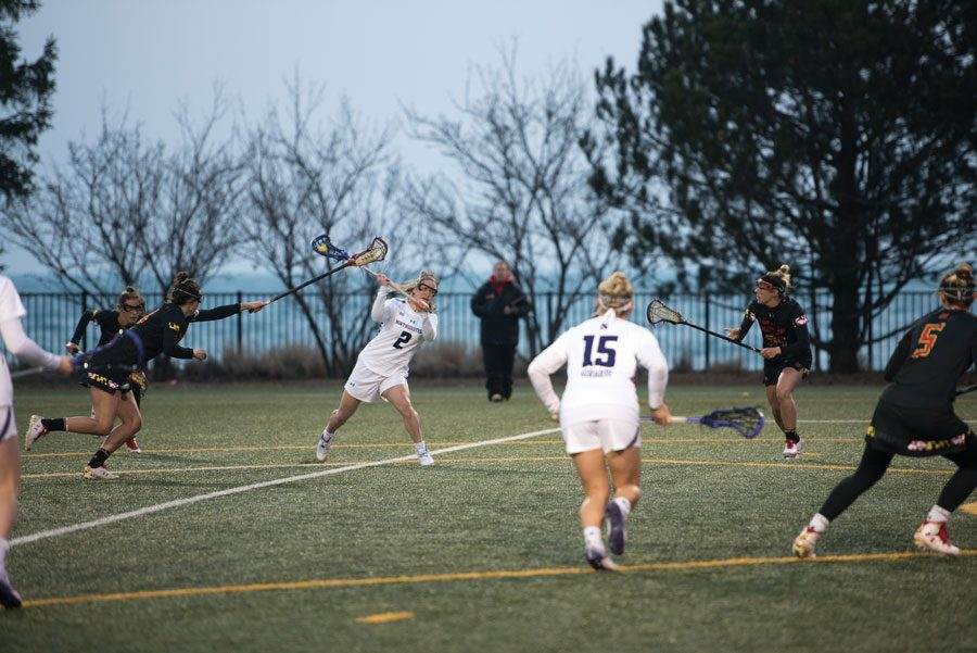 Selena Lasota whips a pass to a teammate. The senior has scored four or more goals in four consecutive games.