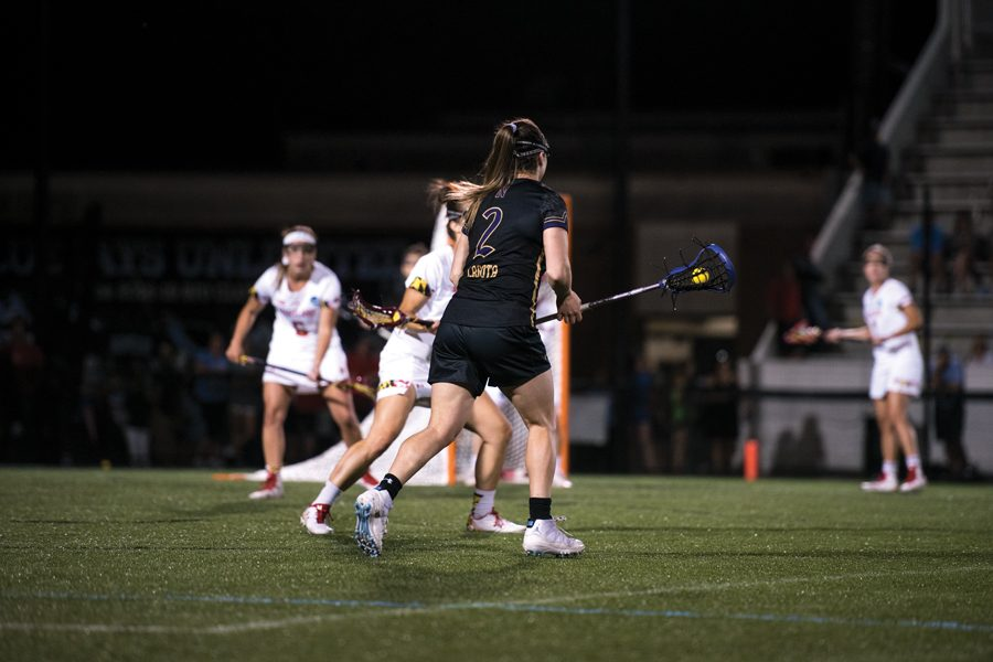 Kelly+Amonte+Hiller+watches+the+field+at+the+2019+Final+Four.+Northwestern%E2%80%99s+lacrosse+coach+led+Maryland+to+two+national+titles+as+a+player+