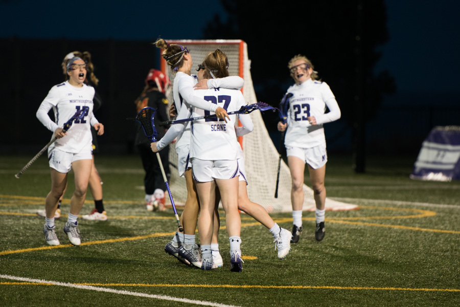Izzy Scane celebrates a goal with her teammates. The freshman is second on the team in both goals and points this season.
