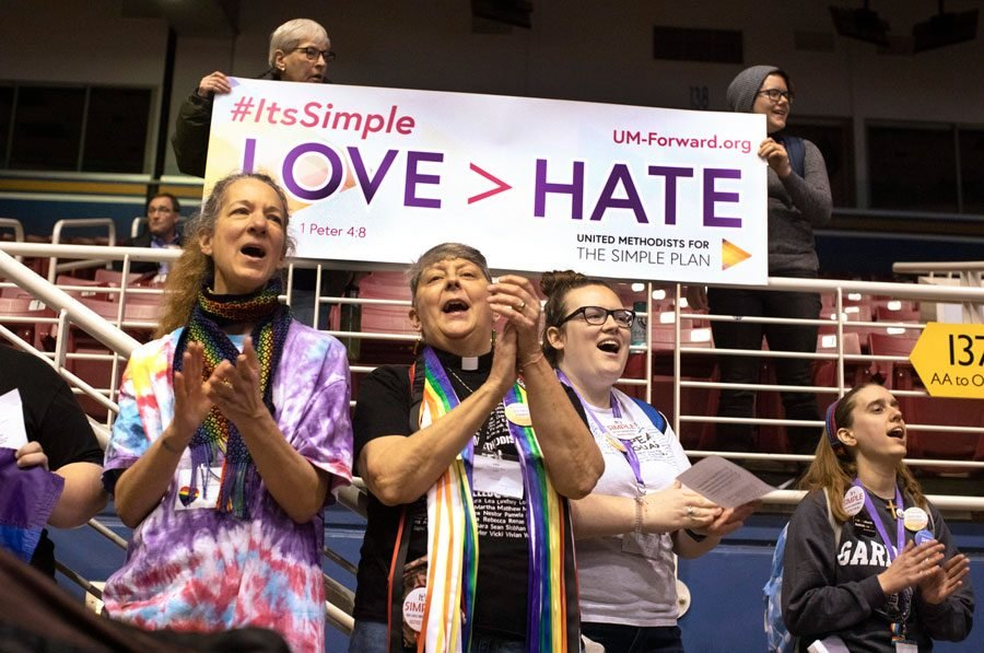 Supporters for the Simple Plan hold banners and sing at the 2019 Special Session of the United Methodist General Conference. Some local Methodists are considering a split from the Church.