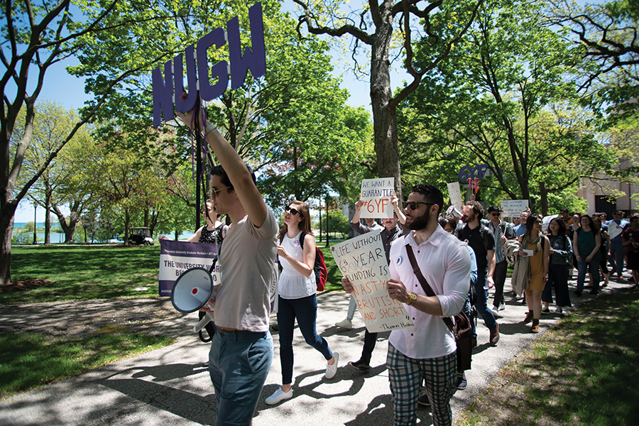 Northwestern University Graduate Workers during a march last week. The National Labor Relations Board plans to revisit a 2016 ruling that classified many graduate students at private schools as employees.