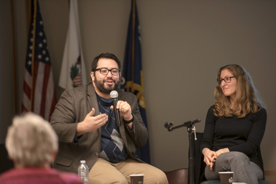 Journalist+Alex+V.+Hernandez+talks+during+the+panel+held+at+Evanston+Public+Library+on+Monday+night.+Hernandez+and+Prof.+Wendy+Pearlman+discussed+covering+refugees%2C+immigrants+and+asylum+seekers+through+storytelling.