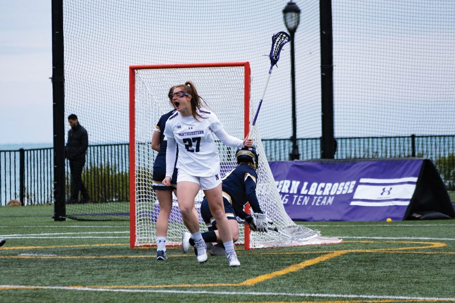 Izzy+Scane+celebrates+after+a+goal.+The+freshman+has+had+a+breakout+season+at+attack+for+the+Wildcats.