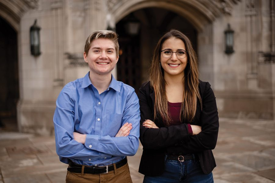 Adam Davies, left, and Izzy Dobbel, right, brought up the necessity of creating exemptions to CARE training requirements for survivors of sexual assault who may not feel comfortable attending a session.