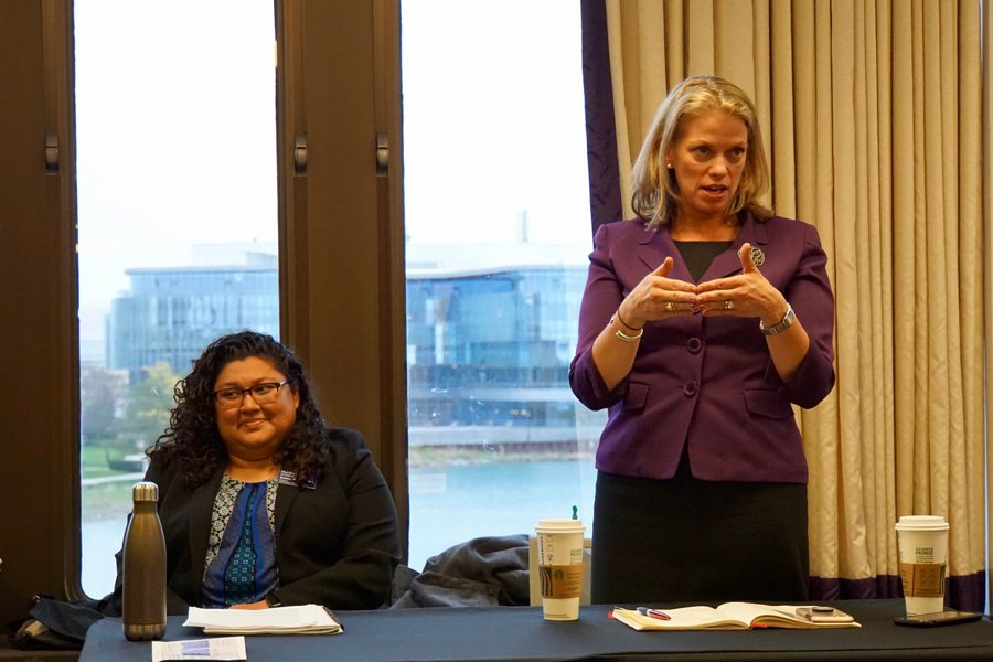 Julie Payne-Kirchmeier, right, speaks to ASG senate about the administration's plans for finding a temporary space for black students during the Black House's renovation.