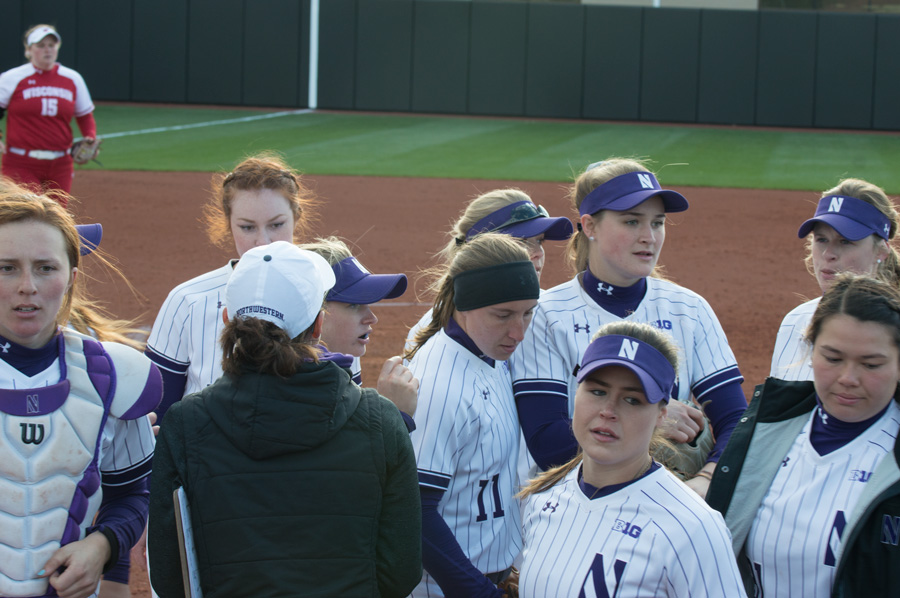 Kate Drohan talks to her team after an inning. The Wildcats head to Minnesota this weekend, trying to win their first Big Ten title in 11 years.