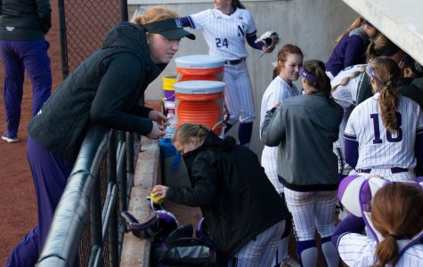 The Wildcats pack up their equipment in the dugout. NU's dugout chants both lighten the mood around the team and keep the Cats focused.