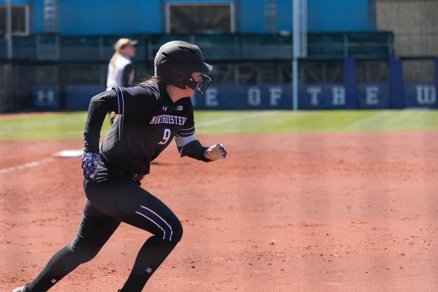 Lily Novak breaks out of the batter's box. The Wildcats will host an NCAA regional this weekend for the first time in 11 years.