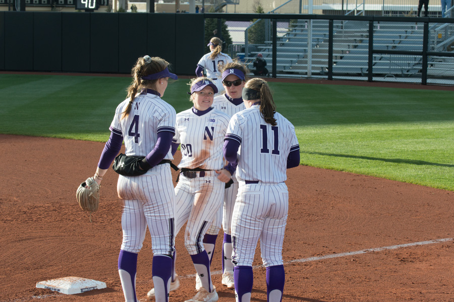 The Wildcats gather in a huddle. NU will face Indiana in the quarterfinals of the Big Ten Tournament on Friday.
