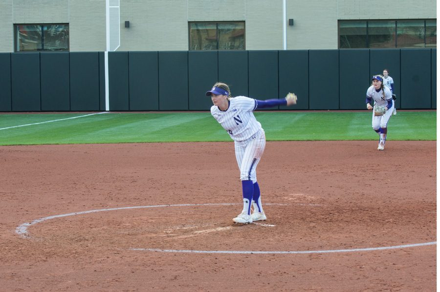 Danielle Williams begins her windup. The freshman threw a shutout Friday, but struggled Saturday and Sunday as the Wildcats lost the series in Minnesota.