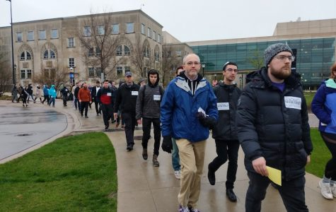 Students march down campus drive as part of Alpha Epsilon Pi's Walk to Remember in memory of Holocaust victims.