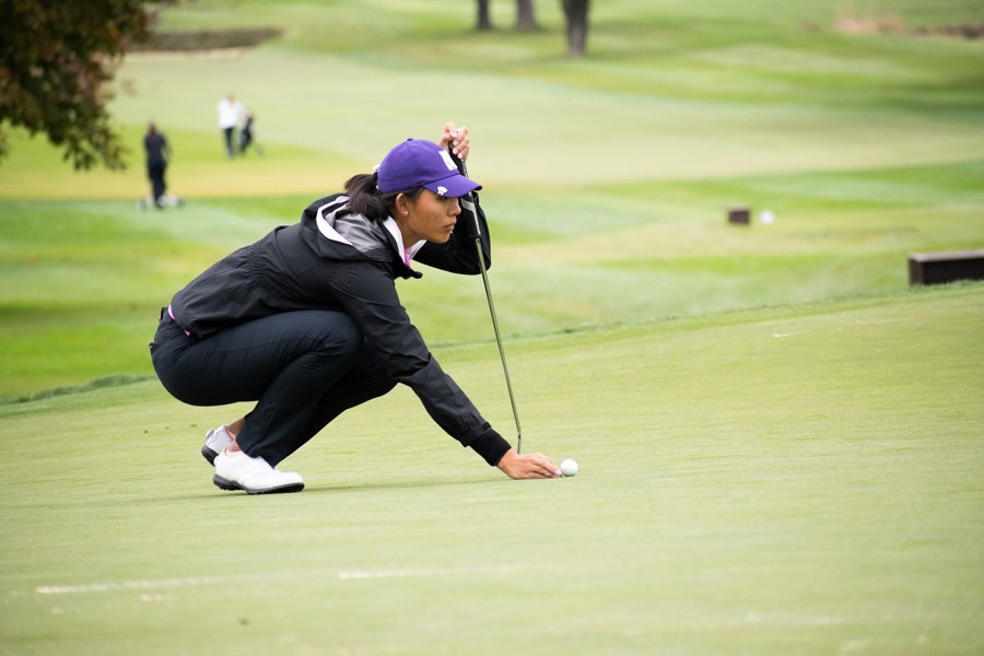 Kelly Su lines up a put. The freshman is one of five golfers who will represent the Wildcats in this weekend's NCAA Championships.