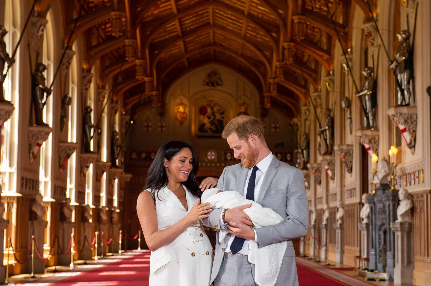 The Duke and Duchess of Sussex with their baby son, who was born on Monday morning, during a photocall in St George's Hall at Windsor Castle in Berkshire, UK.