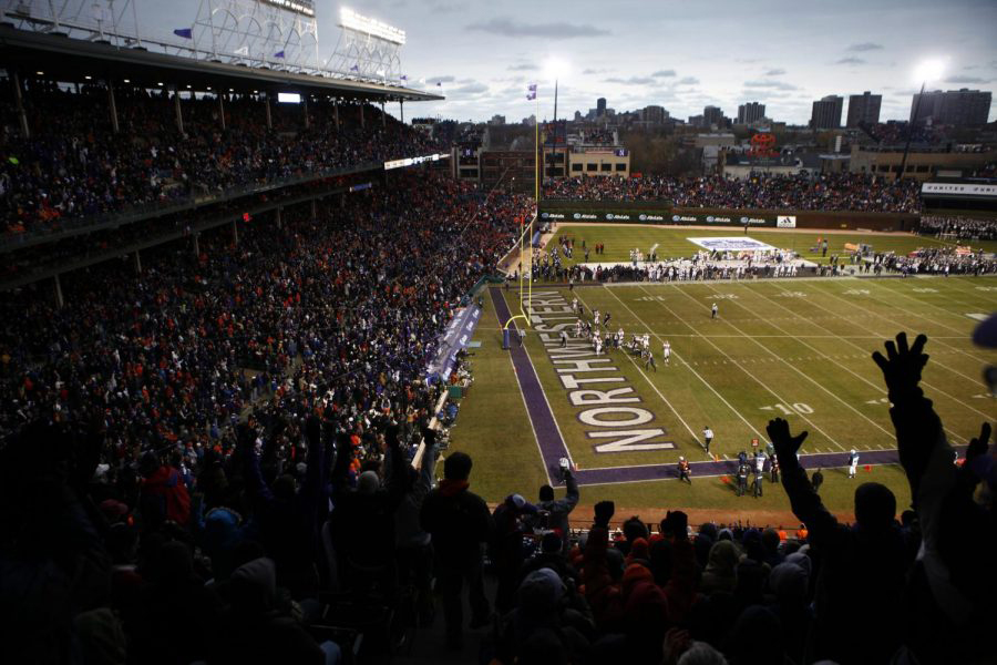 Northwestern fans celebrate a touchdown against Illinois in a 2010 game at Wrigley Field. The Cats will play at Wrigley Field four times in the next ten years, coach Pat Fitzgerald said on a podcast.