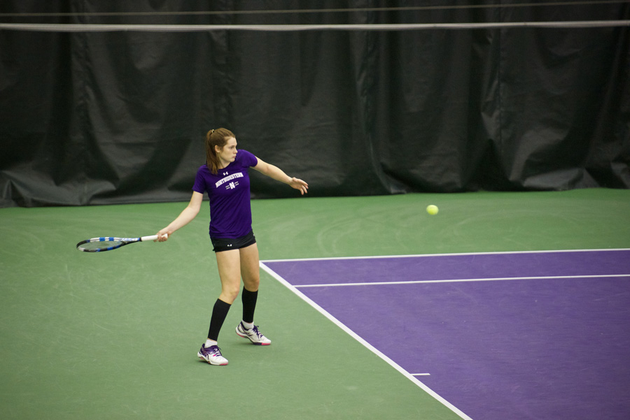 Julie Byrne hits the ball from the back. The junior was the only Wildcat to win in singles play in an NCAA Tournament loss to Princeton on Friday.
